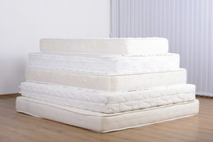 A stack of white mattresses free of mattress stains